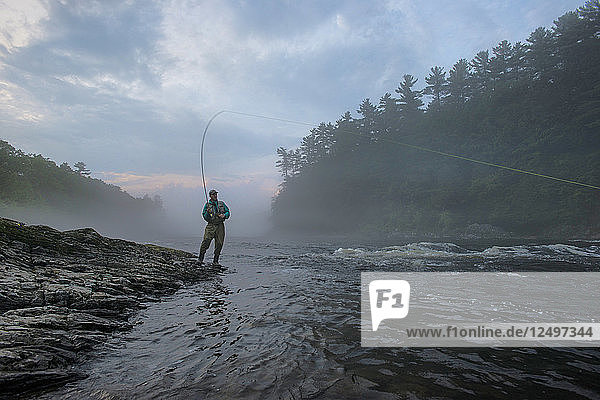 Fly Fisherman Fishing At Kennebec River  Maine