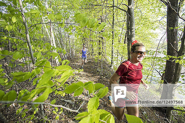 Two Women Trial Running In Forest Near River