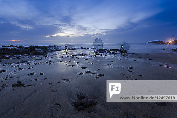 Photographers on the beach at dawn [long exposure]