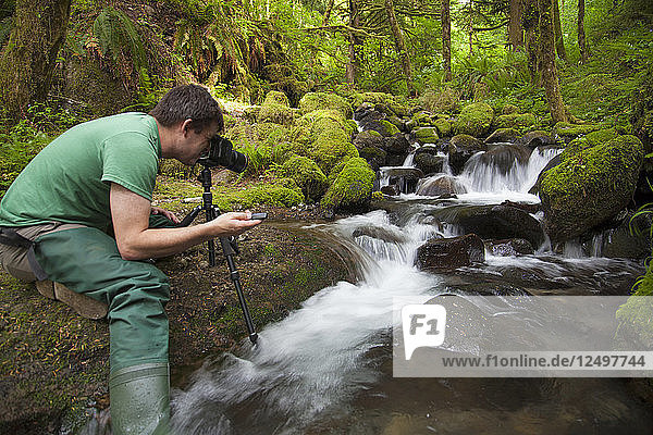 A Photographer Taking Picture Of Waterfall In The Columbia River Gorge