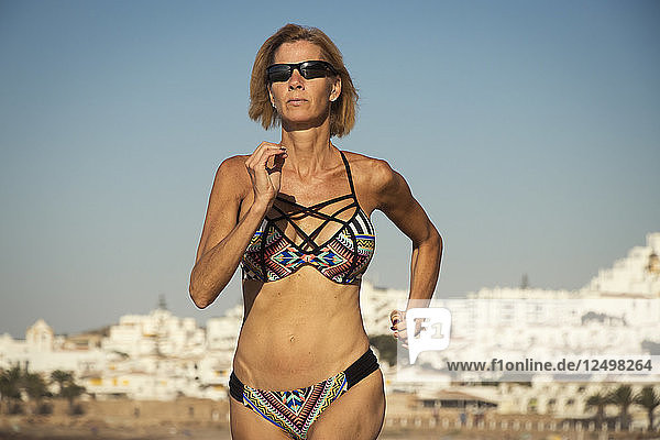 Portrait Of Woman Working Out On The Beach Of Luz  Portugal