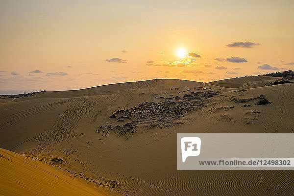 The sun sets over red sand dunes at M?©i N?©  Phan Thi·?øt  B?¨nh Thu·??n Province  Vietnam
