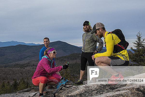 Kristina Folcik  Jerimy Arnold  Ryan Welts and Adam Wilcox having a quick break near the summit of Black Mt.