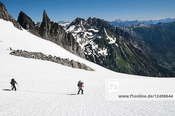 Climbers making their way up the Dana Glacier on the Ptarmigan Traverse  North Cascades  Washington