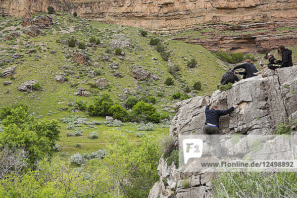 Group Of Rafters Relaxing On Top Of Rock In Dinosaur National Monument