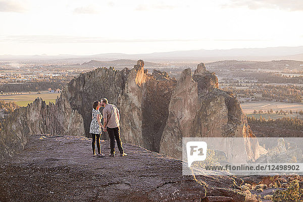 Lifestyle portrait of an engaged couple that loves the outdoors at Smith Rock State Park in Central Oregon.