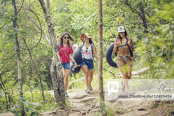 Three young women hike through and swim at Little River Canyon National Preserve.