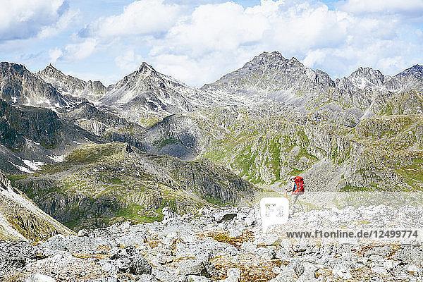 A Woman Hiking On Rocky Landscape In Talkeetna Range In Alaska  Usa