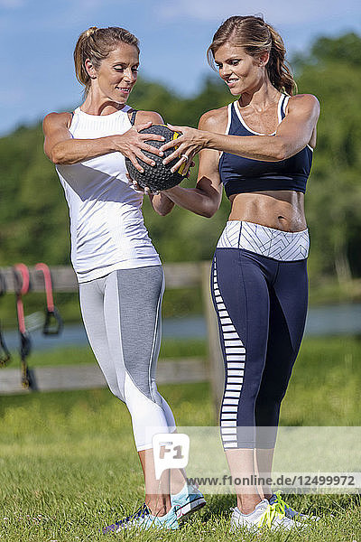 Two Women Doing Exercise With Yoga Ball