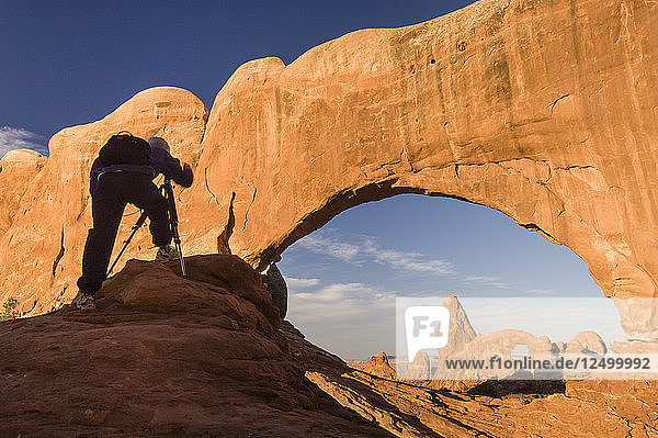 Photographer photographing Windows Arch  Arches National Park