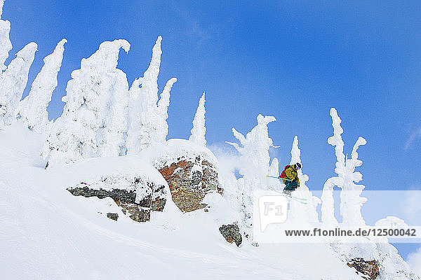 Male Skier Catches Air Off A Cliff At Whitefish Mountain Resort In Montana  Usa