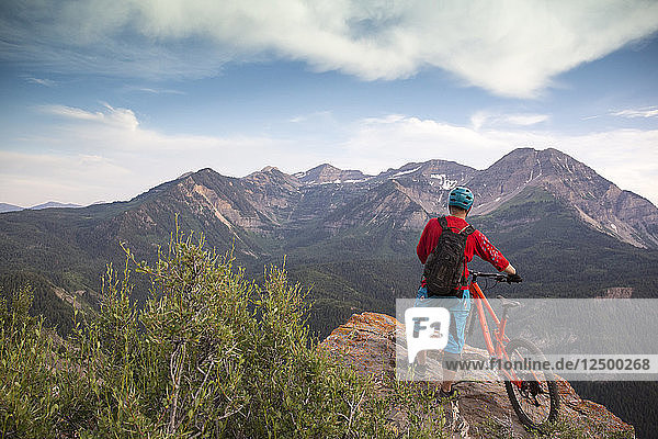Brandon Peterson stops for a mid ride overlook in American Fork Canyon  Utah