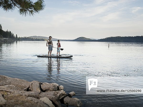father and son paddleboarding in Payette Lake
