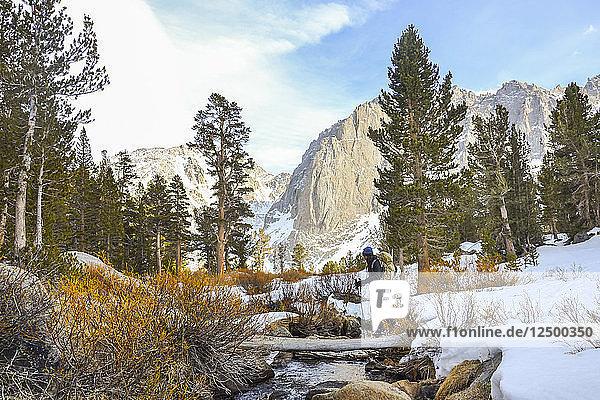 Crossing Big Pine Creek North Fork in John Muir Wilderness  Eastern Sierra Nevada  California.