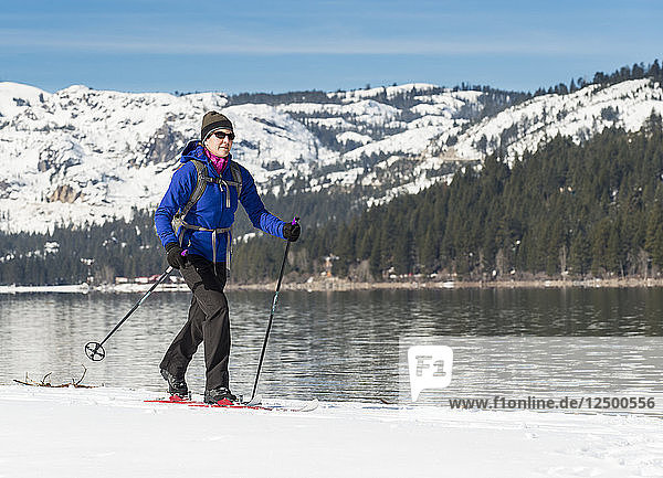 Woman skiing along shores of Donner Lake