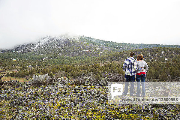 Engaged Couple Exploring The Scenic View Of Private Farm In Klamath Falls  Oregon  Usa