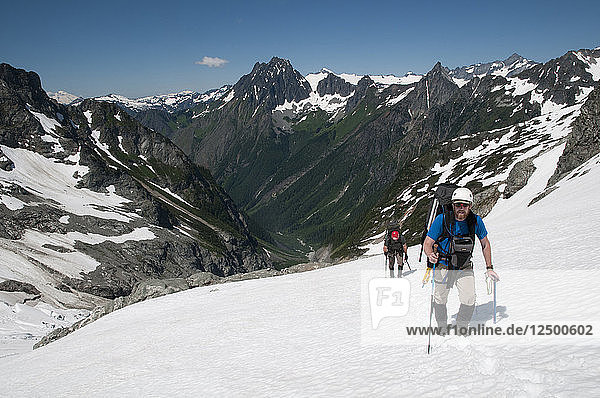 Climbers making their way up the middle Cascade Glacier on the Ptarmigan Traverse  North Cascades  Washington