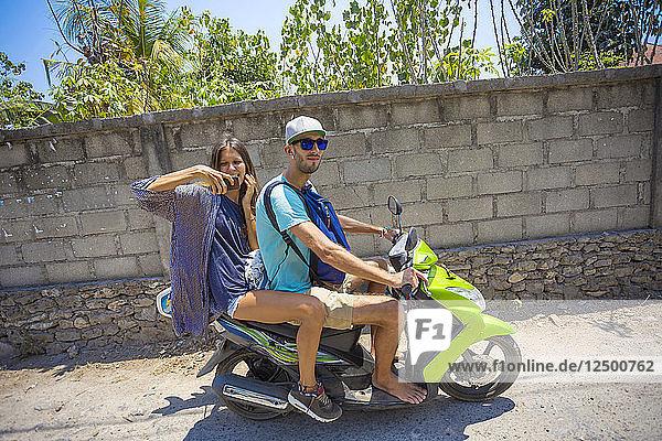 Happy young couple on motorbike