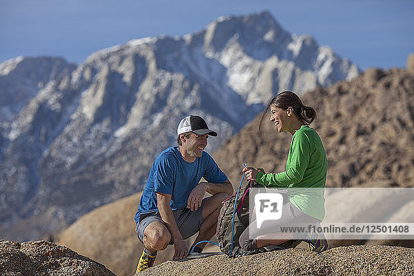 Couple resting while hiking in Alabama Hills
