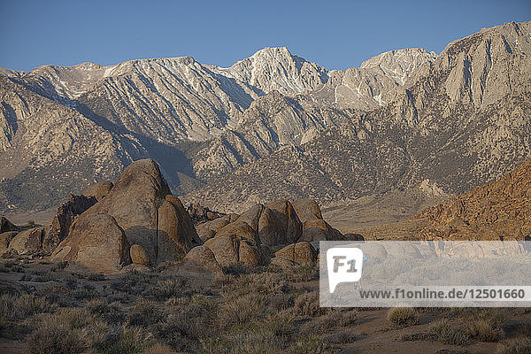 Woman Trail Running In The Alabama Hills Recreation Area Near Lone Pine  California
