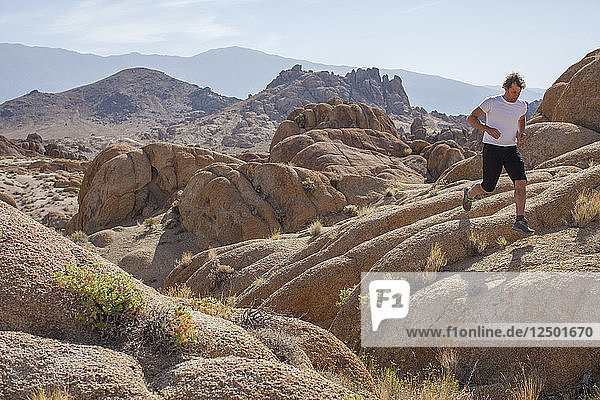 Man Trail Running In The Alabama Hills National Recreation Area  Lone Pine  California  Usa