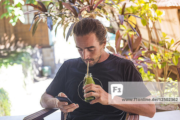 Young man is drinking juice