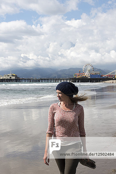 A woman walks on Venice Beach on a stormy day in Los Angeles  Calif.  on March 1  2015. The small amount of rain was not enough to make a dent in the states severe  multi-year drought.