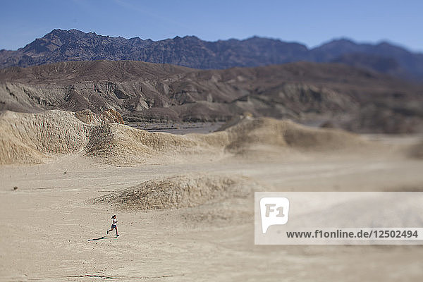 An Adult Woman Running Through Death Valley National Park  California  Usa
