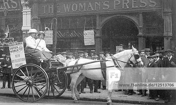A press cart outside the Womans Press  Charing Cross Road  London  July 1911. Artist: Unknown