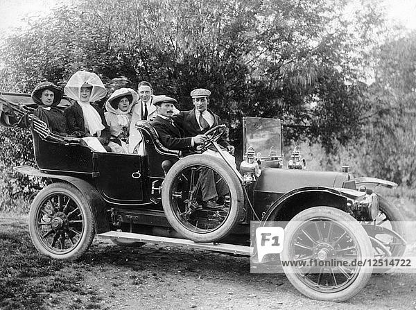 A group of men and women taking an outing in a 1907 Mercedes  1908. Artist: Unknown