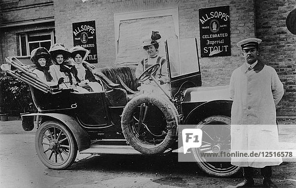 A group of ladies in a car  with their uniformed chauffeur  1910. Artist: Unknown