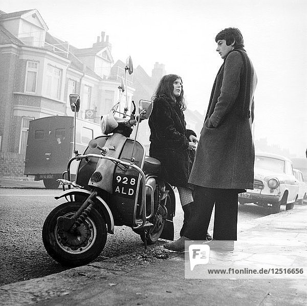 Couple with a scooter  London  1967. Artist: Henry Grant
