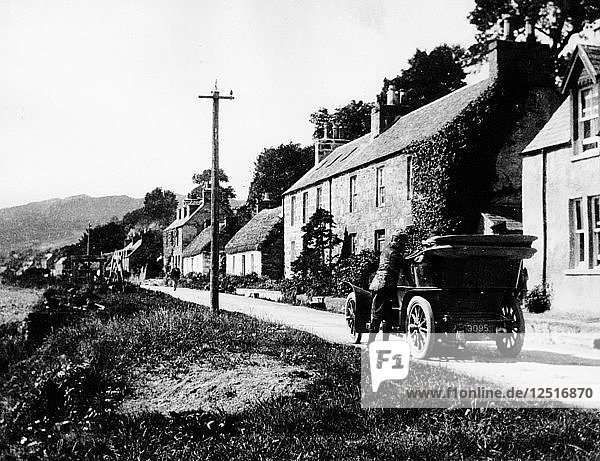 A man by his car in a village lane  1900. Artist: Unknown