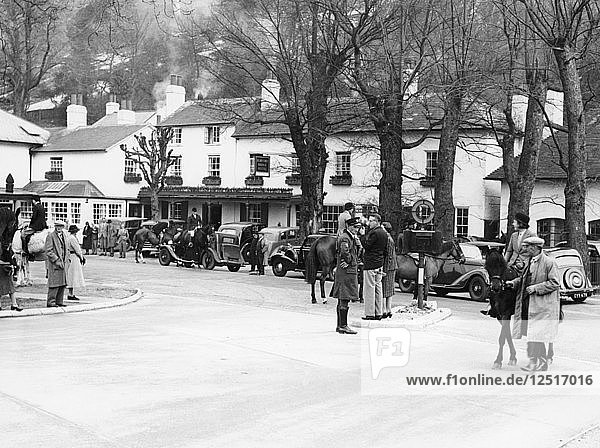 Pedestrians and riders outside the Burford Bridge Hotel  Surrey  (c1930s?). Artist: Unknown