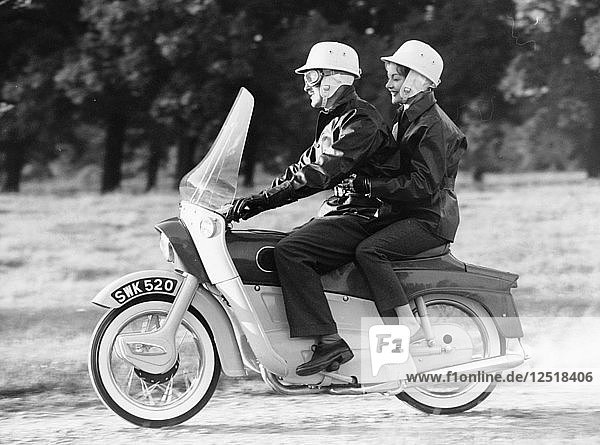 A man and a woman riding an Ariel Leader  1958. Artist: Unknown