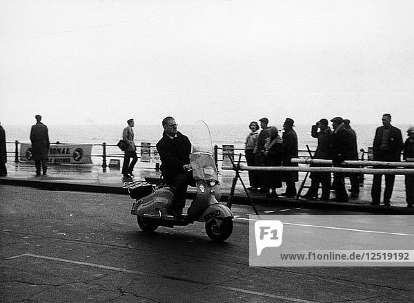 A man on a Lambretta scooter  taking part in the Daily Express rally  1953. Artist: Unknown