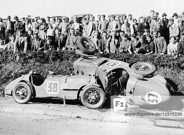 Two crashed cars from the Singer Nine team  possibly at a TTrace  1935. Artist: Unknown