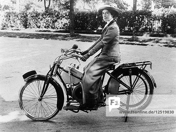 A woman on a Douglas motorbike  (c1913?). Artist: Unknown