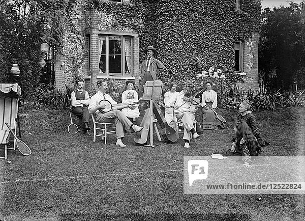People playing music in a garden  c1896-c1920. Artist: Alfred Newton & Sons