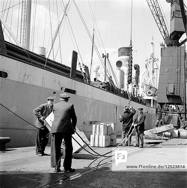 Loading a ship at the North Quay  West India Docks  London  c1945-c1965. Artist: SW Rawlings