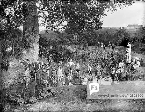 Children playing in a pool on a hot summers day  Cowley  Oxford  Oxfordshire  1914. Artist: Henry Taunt