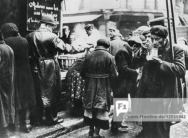 Soup kitchen for the needy  les Halles  German-occupied Paris  February 1941. Artist: Unknown