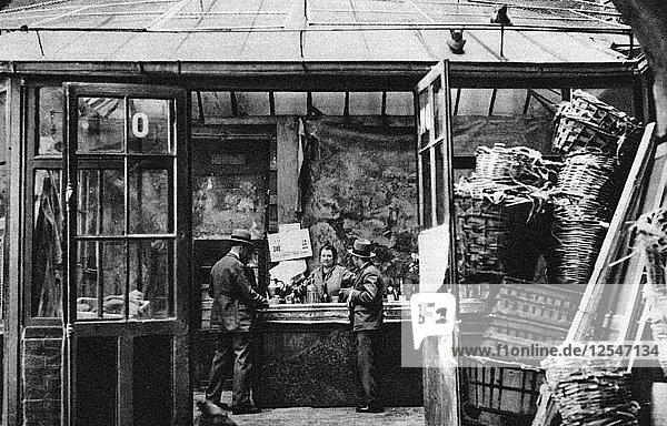 A bar in the Central Market quarter  Paris  1931.Artist: Ernest Flammarion