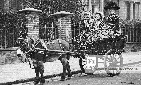 Pearly family in their donkey-drawn moke  London  1926-1927. Artist: McLeish