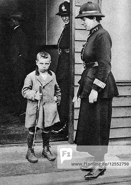 An East End child and a policewoman  London  1926-1927. Artist: Unknown