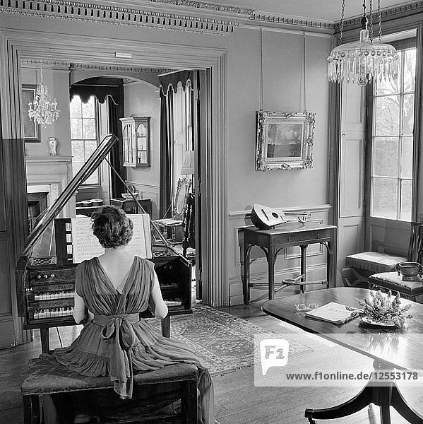 Woman in evening dress playing the harpsichord  Fenton House  London  1960-1965. Artist: John Gay