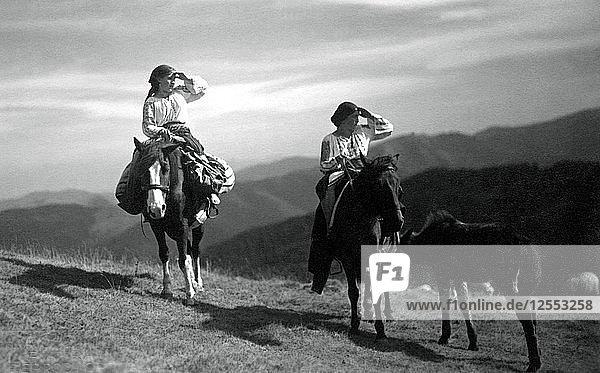 Two women on horseback  Bistrita Valley  Moldavia  north-east Romania  c1920-c1945. Artist: Adolph Chevalier