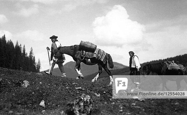 Man and woman leading horses  Bistrita Valley  Moldavia  north-east Romania  c1920-c1945. Artist: Adolph Chevalier