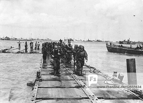 American troop debarkation  on a pontoon built by the Seabees  Normandy  France  1944. Artist: Unknown