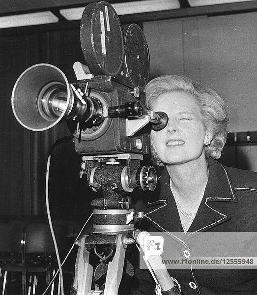 Margaret Thatcher looking through a BBC camera at Heathrow Airport  6th September 1976. Artist: Unknown